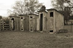 Row of Old Outhouses.must be behind the bunkhouse. Outhouse Bathroom, Outhouse Decor, Outdoor Baths, Outdoor Showers, Outdoor Bathrooms, Old Farm, The Row, Outdoor Structures, Outdoor Buildings