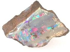Harlequin pattern boulder Opal from from Queensland, Australia.  Harlequin pattern is rare and valuable. This gem was mined in 1937 and has never been cut.