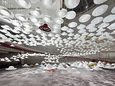 One of Japan's most famous and internationally-known milliners, Akio Hirata, is showcasing more than seventy years of work at the Spiral Garden in Tokyo – The exhibition features more than 4000 white 'ghost hats' floating around and acting as shells of the 'real' hats on display. This beautiful and dreamy installation was created by Japan's most exclusive branding agency Nendo.
