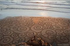 A man takes a single rake to the beach and what he creates is simply amazing >>> This is just one of the photos you have to click through to see them all - stunning!