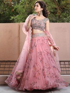 You can be assured to make a great style statement with this pink floral print organza lehenga. This lehenga is enhanced with fancyprint and lace border work .Buy this latest designer lehenga choli online .Paired with matching choli and dupatta Party Wear Indian Dresses, Party Wear Lehenga, Indian Gowns Dresses, Dress Indian Style, Indian Fashion Dresses, Indian Designer Outfits, Indian Wedding Dresses, Maxi Dresses, Gown Party Wear