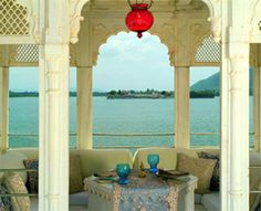 Taj Lake Palace, Rajasthan, India. The hotel is a white marble palace on a tiny island in the still waters of Lake Pichola.