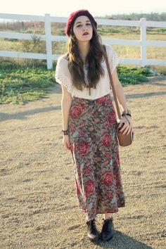 Beanie, cream top, maxi skirt, satchel.