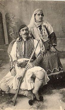 Hellenic Genealogy Geek - Family History Research Tools for Greek Genealogy: Picture Postcard - Greek Soldier and costumed woma...
