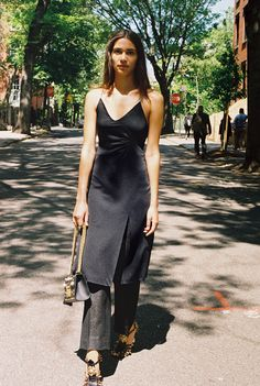 Kaya Wilkins, x in a vintage black diamanté dress, vintage black trousers, Gucci Padlock bag with pearls and studs, and Gucci sandals with studs, metal flower, and glass pearls