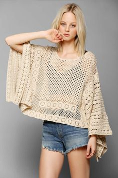 I'm totally feeling this airy poncho/sweater -- it's basically a big rectangle with a neck opening in the middle, and the bottom edges seamed to make sleeves. This pattern could totally be reverse engineered. (Pins And Needles Crochet Poncho Sweater - Urban Outfitters)