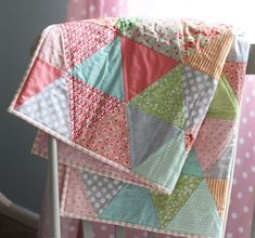 Pretty Triangle Quilt from Cluck Cluck Sew Cute for the receiving blanket quilts for the kids??? Perfect for a little girls bedroom