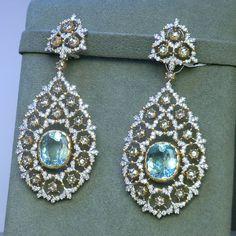 A pair of #Earrings set with Diamonds, Gold and #Aquamarine by #Buccellati #jewelry #jewellery #joaillerie #bijoux #diamond #gold #gem #followme #follow #like #me #cute #beauty #beautiful #art #instagood #instamood #handmade #life #happy #amazing#design#bestoftheday #highjewelry #love #mariigem#finejewelry