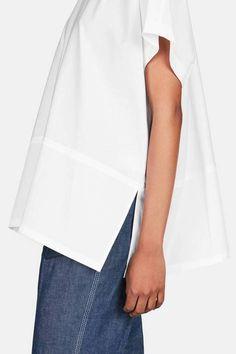 beautiful poplin swing shirt and denim by the line. a sleek and stylist capsule wardobe outfit idea – minimalism.co