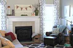 Love this living room with cozy, fall pillows, a comfy reading corner and pretty mantel! | Happy Fall-i-Days Home Tour | TheTurquoiseHome.com