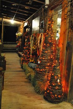 Prim Fall Gathering...lighted grapevine trees on the porch...Olde Mill Primitives.
