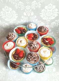 Selection of little cakes Chiffon cakes filled with custard cream  Cupcakes with chocolate ganache Mini fruit tarts