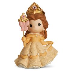 [Shine on]Belle has her wand ready to bring a little magic into your life with this charming figurine by Precious Moments. Crafted in porcelain bisque, ''Your Beauty Shines From Within'' is accented with faceted gems for a little extra sparkle.