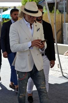 Supreme in cream. File under: Panama hats, Street style, Double breasted, Blazers, Denim