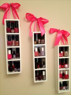 Cute nail polish storage. I found these wooden shelves at JoAnn's, they come in black or white. I drilled holes in the top and pulled the satin ribbon through to tie in a bow for hanging. I used one inch ribbon without wire.
