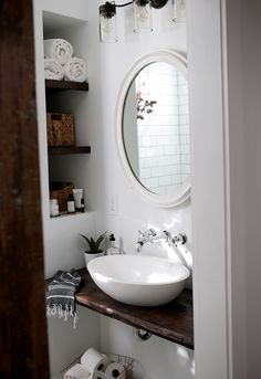 It is amazing that a such tiny closet in an old house can be transformed into such a bright and beautiful farmhouse bathroom.