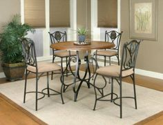 Cramco Ravine 5 piece Counter Height Dining Set by Cramco. $355.00. Cramco Ravine dining set has a rustic appeal. The 45 inch round table features an espresso colored frame with smooth oak veneer wood top. The matching chairs feature light brown colored Micro Suede upholstered seats and open backs with a decorative checkered circle in the middle.