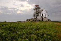 Abandoned lighthouse, Fish Fluke Point, Canada by Robert Williams