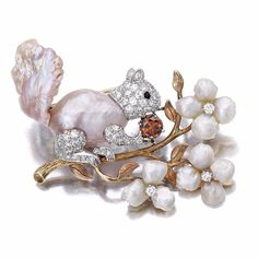 Vintage squirrel brooch of gold, pearl, diamond and red gem by William Ruser