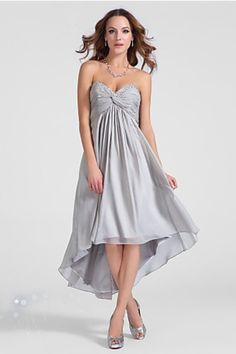 """Start out searching for your perfect short strapless silver prom dress by flipping through magazines and online to see what kind of dress you are most attracted to. Then hit the stores with an idea in mind of what you are looking for. Try on as many dresses as you can; your idea of the """"perfect dress"""" may not be as well suited for you as another style. Don't limit yourself."""