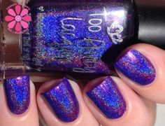 The Glow Within, from The Sizzling Collection, is a medium dark purple linear holo with a gorgeous blue glow.First photo is swatched by Cosmetic Sanctuary.*Using a good base coat is strongly recommended to protect your nails from possible staining. *Please read the Shipping and Shop Policy pages before you commit to purchase.