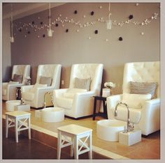 Pedicure stations with great chairs. Love the elevated design and the sparkly pillows add a nice touch!