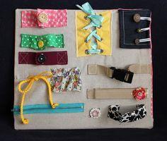 Tableau de manipulation Montessori DIY. A partir de 12 meses