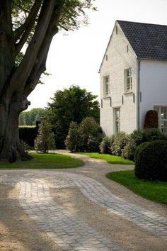 White brick, driveway pavers, landscaping