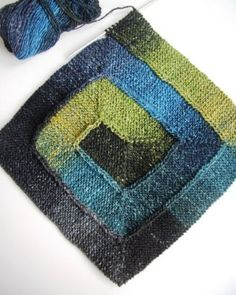Spiral knit, self-striping blanket