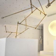 Ghaith & Jad build brass rod installation  inside Beirut boutique