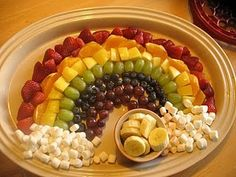 Fruit rainbow. So cute and a fun way to get the kids excited to eat healthy. Made this for New Years and the kiddos really liked it.