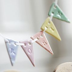 Personalised porcelain bunting in candy colours Clay Fimo Clay, Polymer Clay Crafts, Ceramic Clay, Clay Christmas Decorations, Christmas Crafts, Pottery Handbuilding, Clay Ornaments, Paperclay, Cold Porcelain