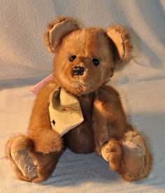 Check this out- this bear was handmade using an old mink coat.  It's from a web site called Fairy Godmother Creations.  All the bears and dolls are made from peoples old furs and memory clothes.  Really amazing.