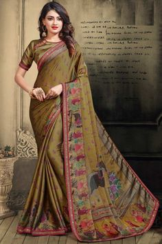Dark Olive Green chiffon saree with dark olive green satin blouse. Embellished with stone work embroidery. Saree with ,Asymmetrical Neck, Half Sleeve. It comes with unstitched blouse. New Saree Designs, Olive Green Color, Green Art, Sari Dress, Chiffon Saree, Traditional Sarees, Green Satin, Party Wear Sarees, Printed Sarees