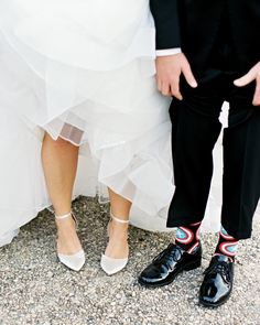 "Brittany wore pointed ""Starling"" heels from ASOS, and Alex paired his black shoes with fun superhero socks. The groomsmen all wore the same pair. #weddingshoes #weddingaccessories #weddingsocks #bridalshoes 