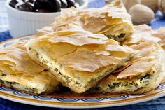 Spanakopita, Greek spinach pie with feta cheese and filo party on on plate with Greek white wine, olives and walnuts Greek Recipes, Pie Recipes, Cooking Recipes, Healthy Recipes, Simple Recipes, Spanakopita Recipe, Greek Spinach Pie, Greek Dishes, Snacks Für Party