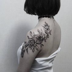 Roses covering the shoulde and the shoulder blade.