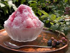 "Kakigōri (かき氷) is a Japanese shaved ice dessert flavored with syrup and condensed milk. Popular flavors include strawberry, cherry, lemon, green tea, grape, melon, ""Blue Hawaii"""