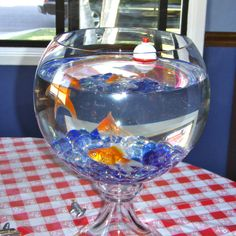 Camping/Fishing Centerpieces: Used fish bowls, goldfish and fishing lures. Brought the fish to our camp out!