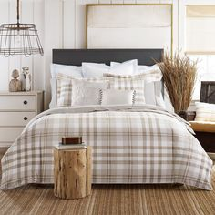 With a combination of soft browns and whites, this plaid comforter set from Tommy Hilfiger will give your bedroom a calm atmosphere. Perfect for any size bed, this set includes a comforter and shams to give your room a complete look.