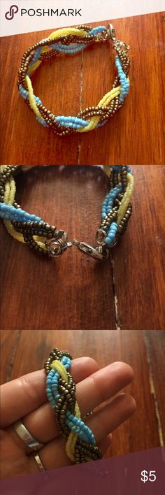 Braided Bead Bracelet Blue Yellow Bronze Handmade Beautiful handmade braided bracelet. Bronze, blue & yellow. Check out my bundle discount - you only have to find two cute things to get a discount!! Jewelry Bracelets