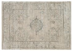 Elegant motifs create a timeless appeal on this stunning foundation. Machine-made from viscose, it features a stunning sheen that will make an instant impact on your home. A rug pad is recommended...