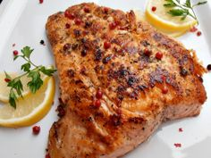 Salmon fillet with red pepper and lemon