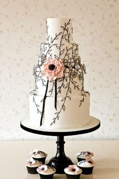 Black vines and a blush anemone on a beautiful wedding cake