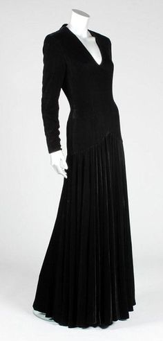 The Bruce Oldfield black velvet evening gown that Princess Diana wore at the gala opening of 'Les Miserables' at the Barbican centre in 1985 fetched £50,400 at auction.