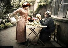 Woman buying vegetables, France, c. 1908   16 Edwardian Colour Photos That Will Make You Feel Like A Time Traveller