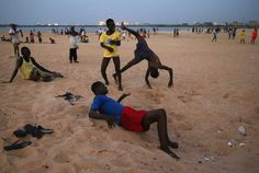 Boys play on the beach next to the Atlantic Ocean in the West Point township on Jan. 31, 2015 in Monrovia, Liberia.