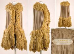 Chanel Beige Georgette and Tiered Feather Manteau   French, circa 1925   Calf length, of self backed crepe georgette, the semicircular shoulder cape with top of parallel curved shirring with three rows of stitching and ripple pleats descending into same at base, rectangular collar and applied border a profusion of tiered cock feathers forming a cape over-collar with continuous trim to extravagant 18 inch scalloped fringe-form hem