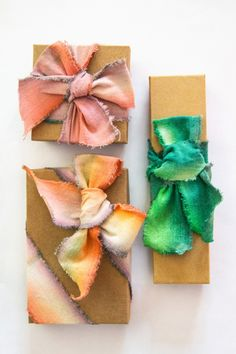 These ribbons are amazing for any kind of gift, and they are easy to make! Prepare raw muslin ribbon, food coloring or fabric dye, small bowls for dye, water, paper towels. Put the fabric dye with a little water in a small bowl. The more water you add, the lighter the color will end up....