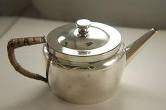 A Rare Sterling Silver Tea Set by Christopher Dresser